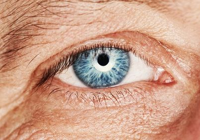 A close-up photo of an older man's eye