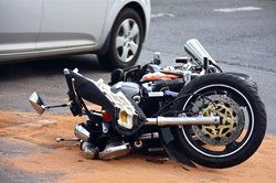 A motorcycle lying in the road after an accident