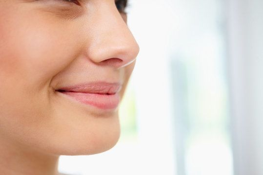 Smiling woman with well-defined chin