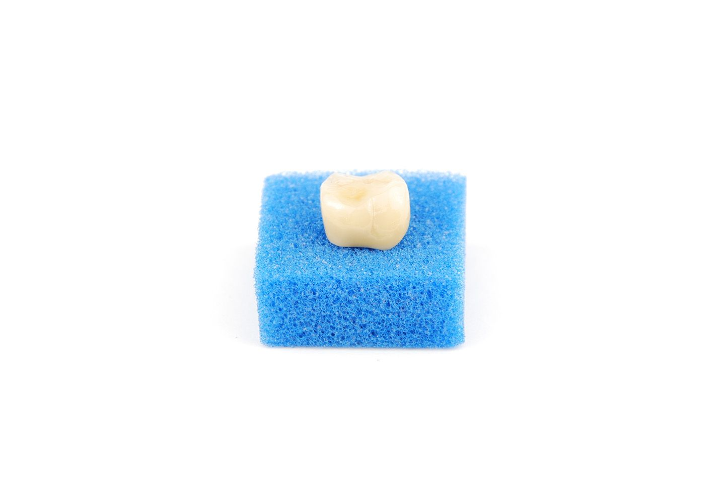 A tooth-colored dental crown