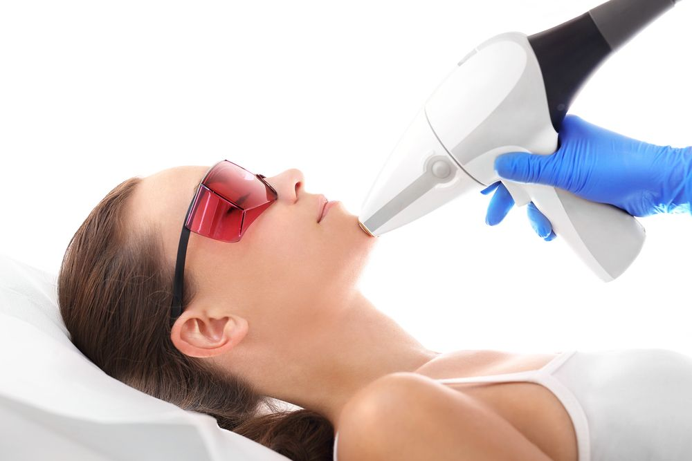 Woman receiving laser skin resurfacing on the face