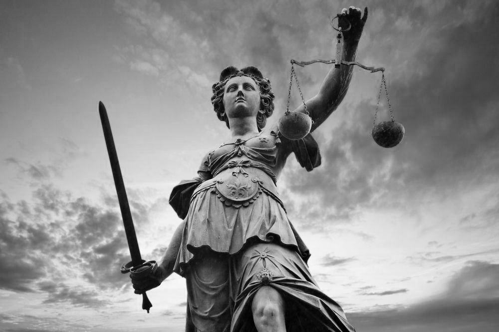 A statue of lady justice and her scales