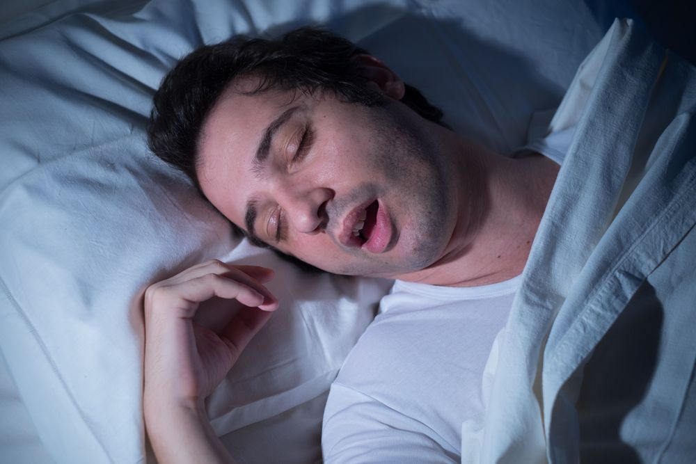 Photo of a man in bed asleep