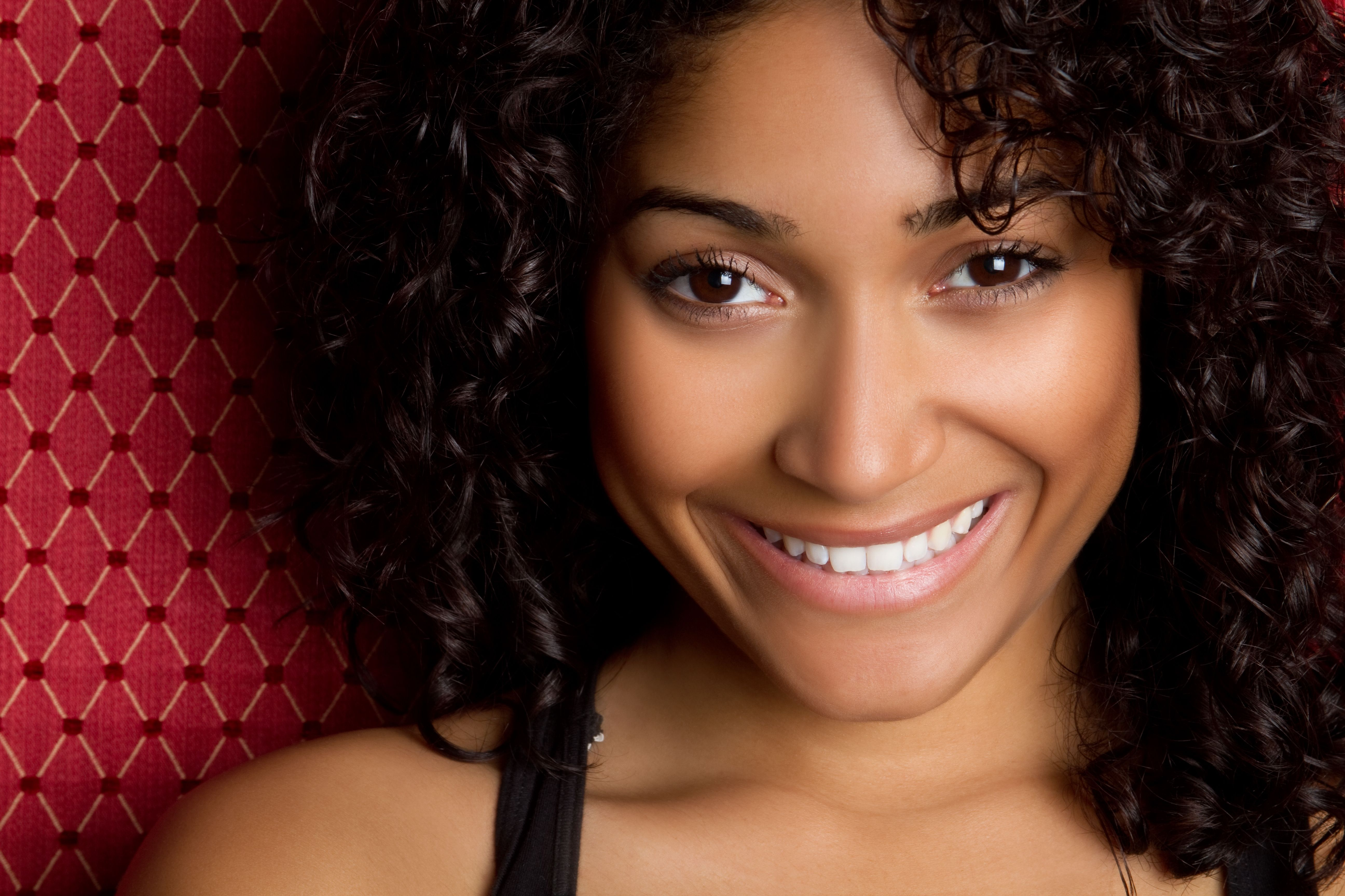 Portrait of beautiful smiling woman with dark brown hair