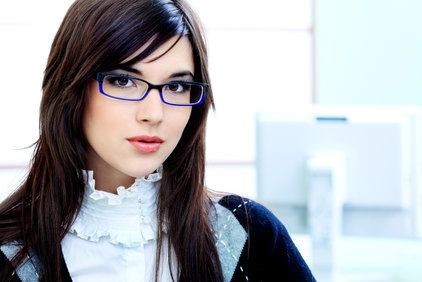 A beautiful brunette woman wearing eyeglasses.