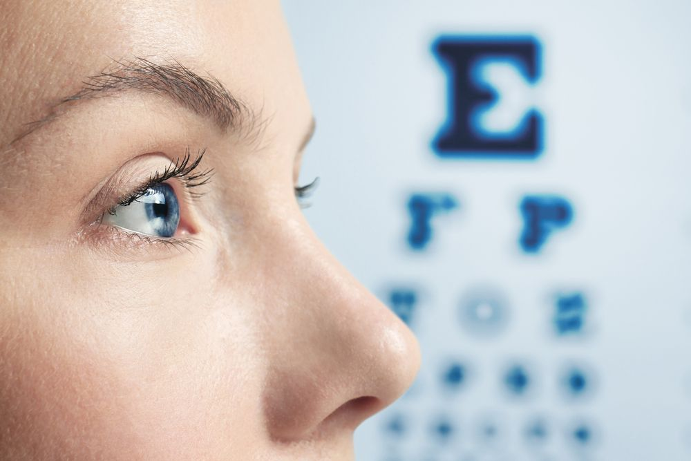 Looking at an eye chart for vision testing