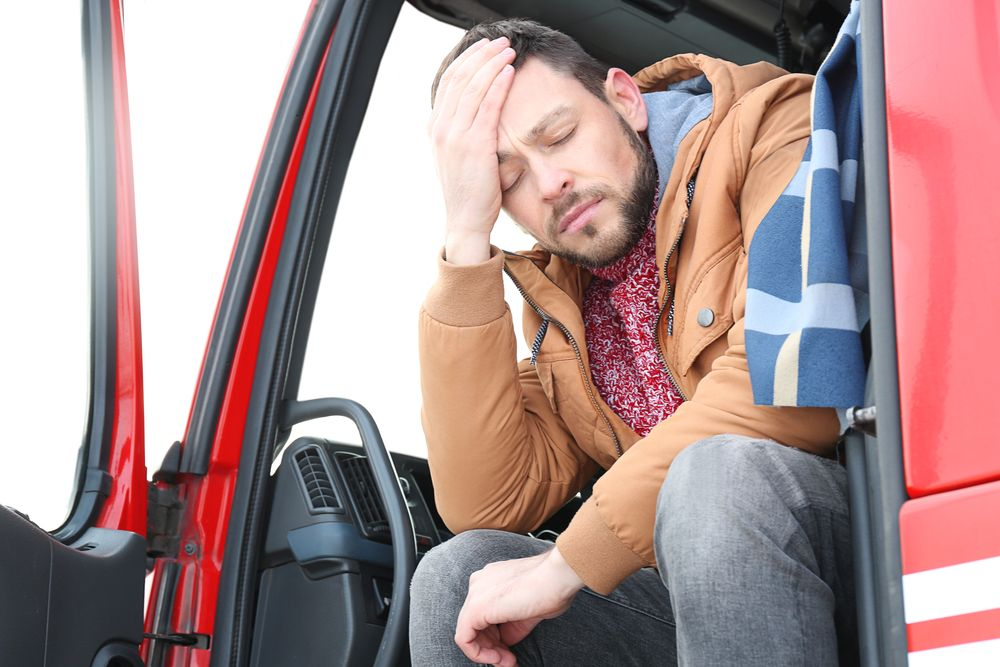 Commercial large truck driver suffering from fatigue