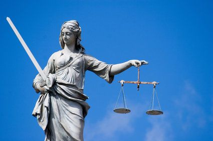 Statue of woman holding scales of justice
