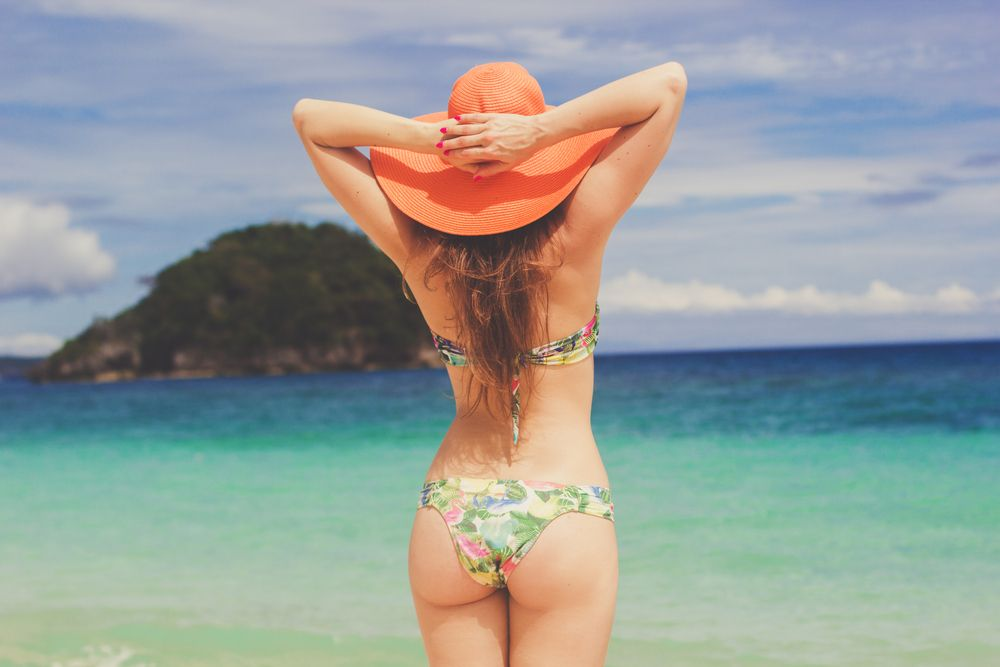 View of a woman in a bikini, her beach body perfectly toned for summer after plastic surgery