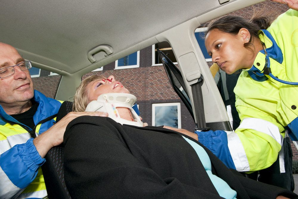 A woman in a neck brace after a car accident