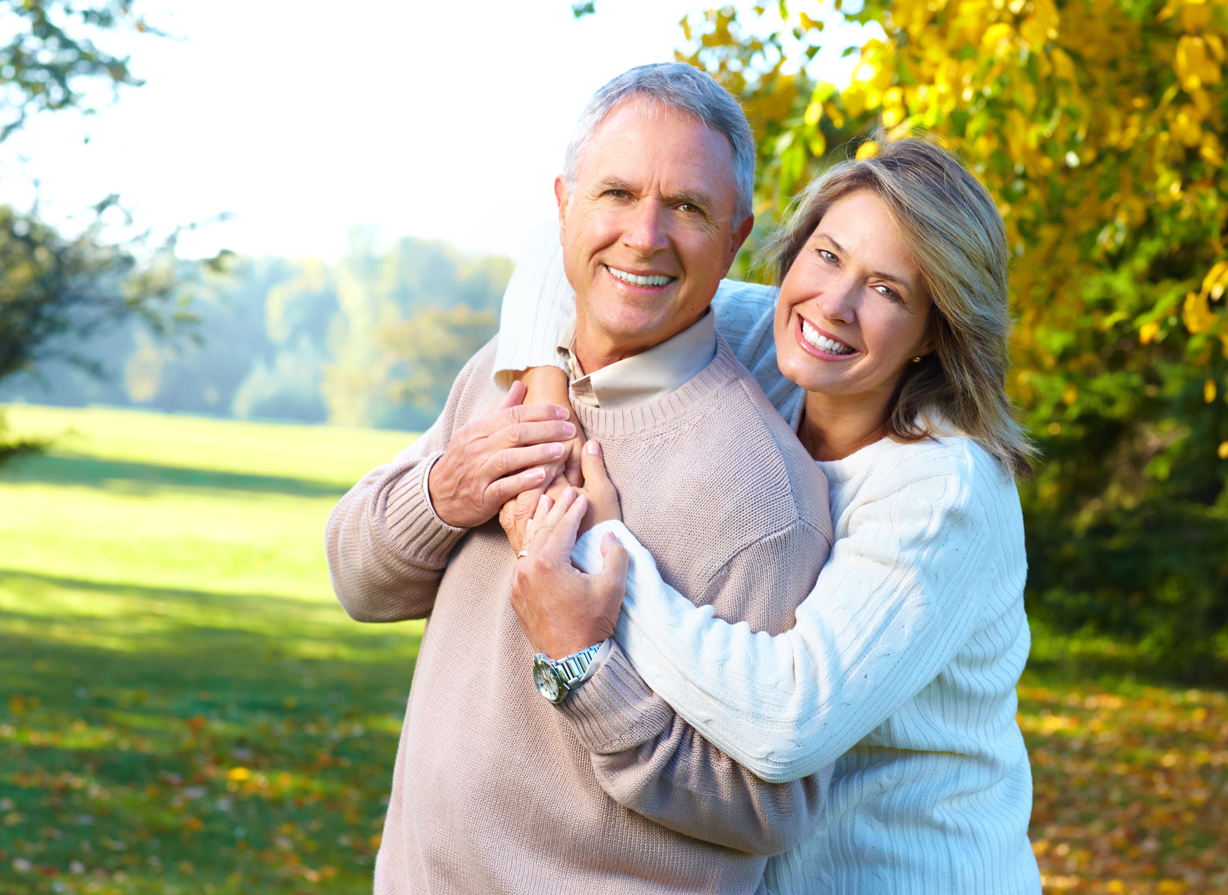 Middle-aged couple smiles to show two attractive rows of white teeth