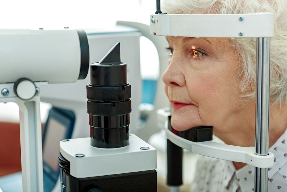 An elderly woman at an eye exam