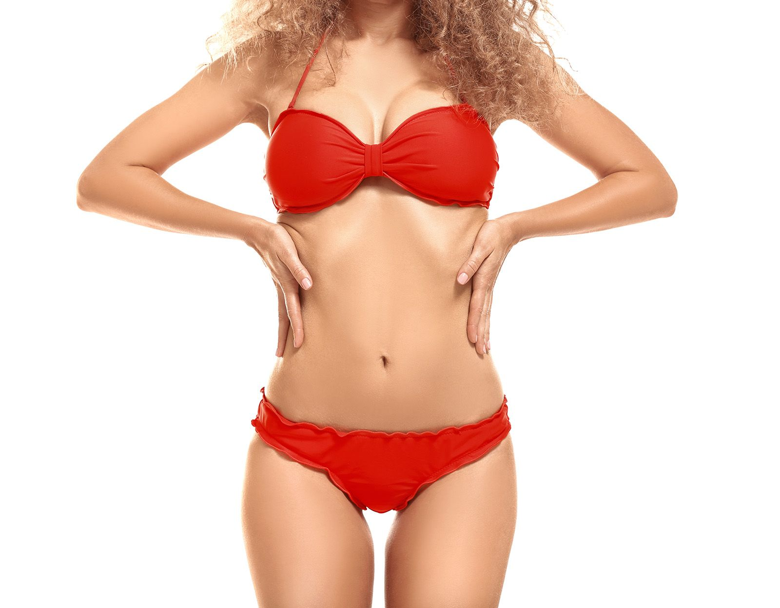 Woman with her hands on her hips wearing red underwear