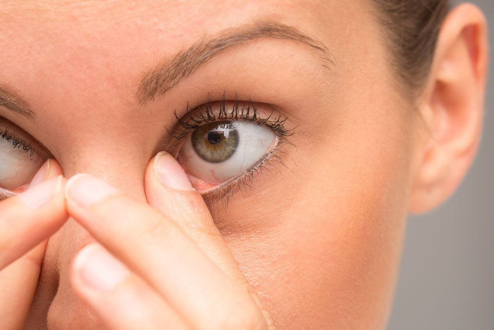 Up close photo of woman rubbing her eyes