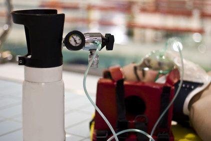 Man using an oxygen tank