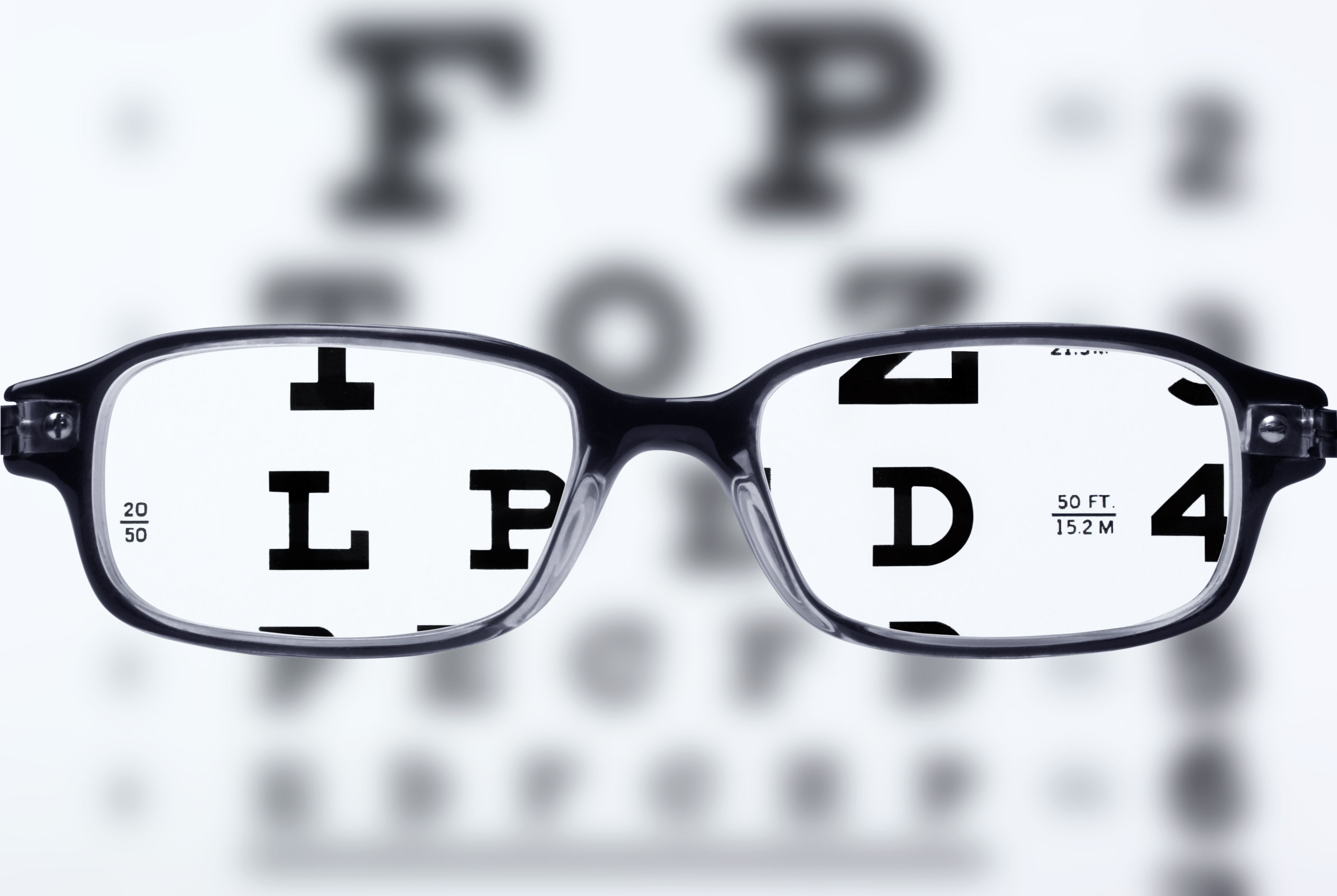 How glasses improve vision looking at an eye chart