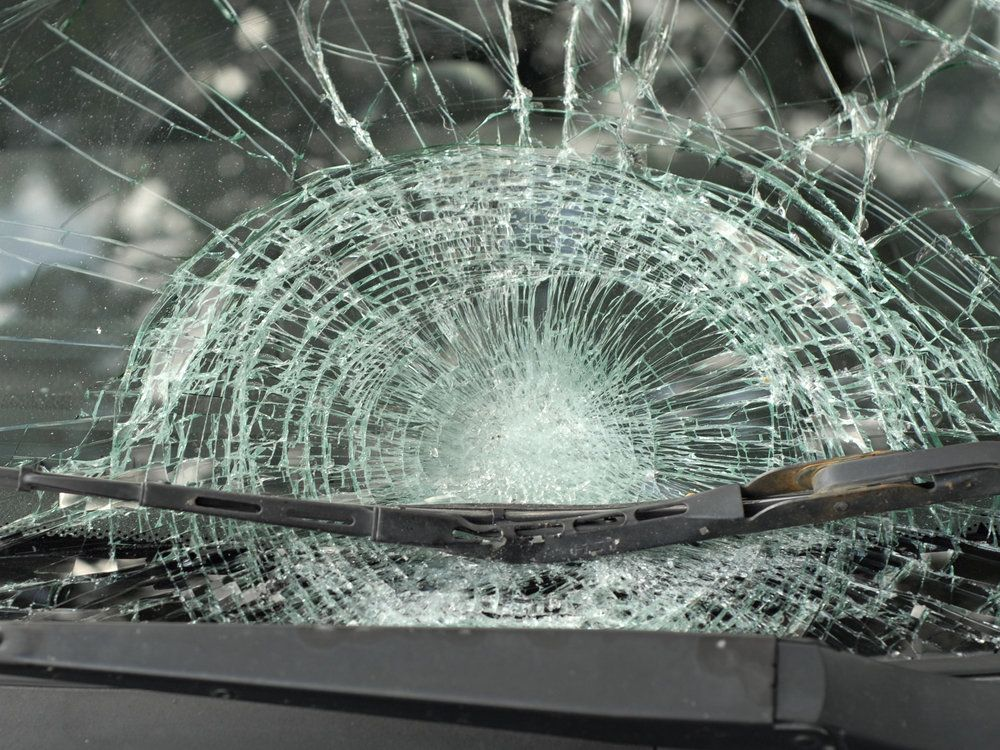 Shattered windshield after car accident in the fog